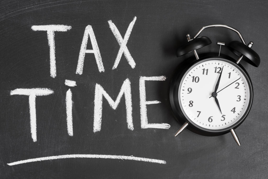 tax time words with alarm clock